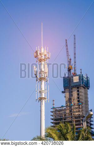 communication tower for 4G 5G network telephone cellsite with dusk sky