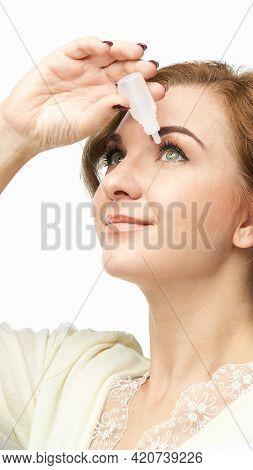 Woman Using Eye Drops. Medicine Treatment. Eyecare Human Problem. Ophtalmology Dropper. Home Optomet