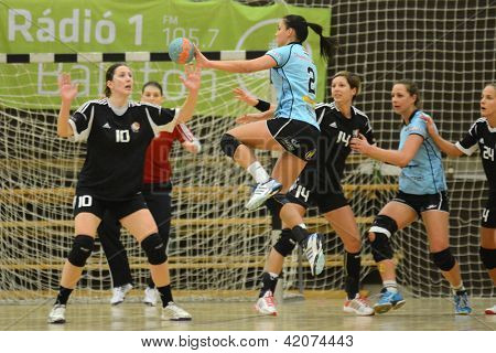 SIOFOK, HUNGARY - FEBRUARY 9: Fruzsina Azari (blue 2) in action at a Hungarian National Championship handball match Siofok KC (black) vs. Fehervar KC (blue) February 9, 2013 in Siofok, Hungary.