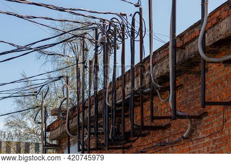 Lots Of Wires Sticking Out Of An Old Brick Electrical Substation Building