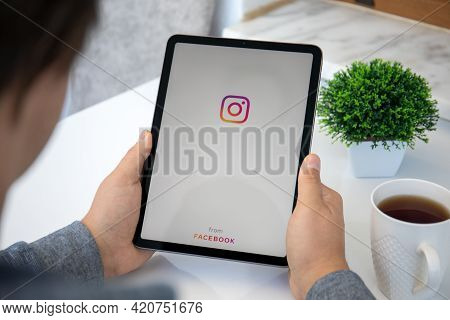 Alanya, Turkey - May 11, 2021: Man Hand Holding Ipad Air With Social Networking Service Instagram On