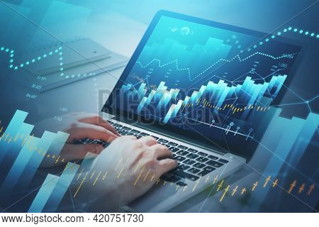 Businessman Hands Or Stock Trader Analyzing Stock Graph And Financial Indicators Of Market Using Lap