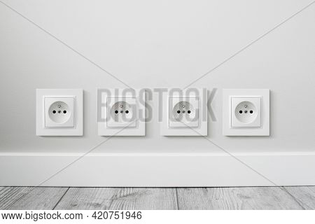 New Electrical Socket Isolated On Gray Wall. Renovated Studio Apartment Power Supply Background. Gra