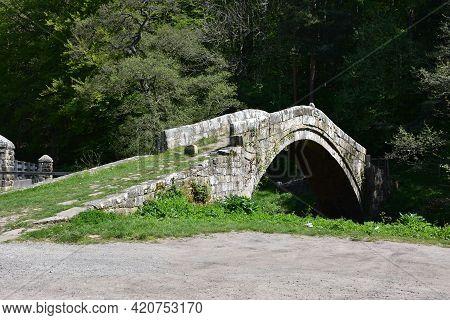 Historic Beggar's Bridge Over A River In England.