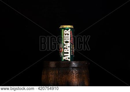 Can Of Albacher Beer On Beer Barrel With Dark Background. Illustrative Editorial Photo Shot In Bucha
