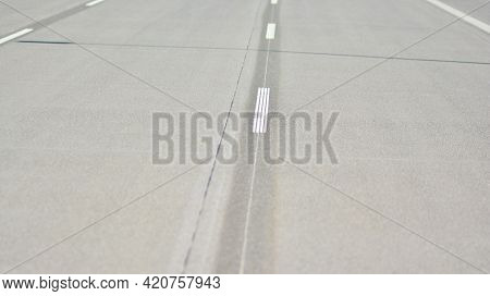 Straight Modern Concrete  Motorway With Bright Road Marking. Transportation Road System Infrastructu