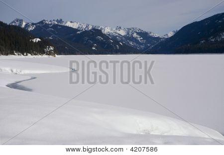 Snowy Lake In The Sunshine