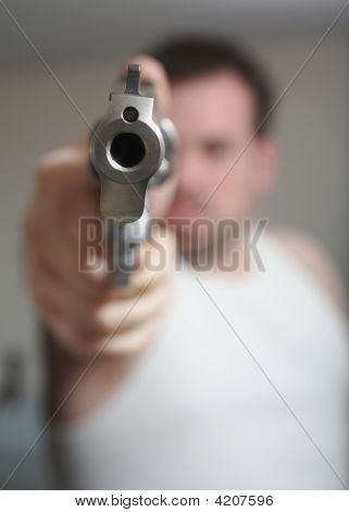 Anonymous man aiming gun at the viewer poster
