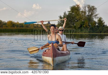 Canoeing in late afternoon sunlight, Lake Tisza, Hungary