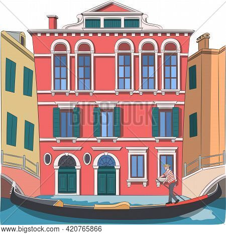 A Gondolier In A Gondola Boat Sails Along The Canal Of Venice.