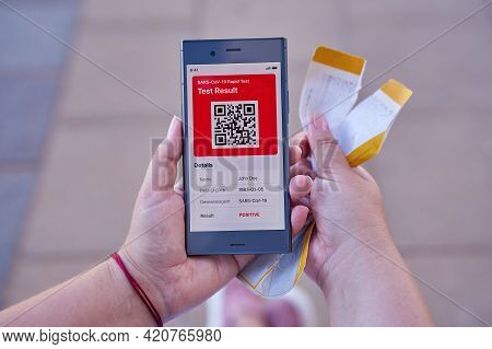 Person Received Message On App Mobile About Positive Covid-19 Test Result, Torn Boarding Pass In Han