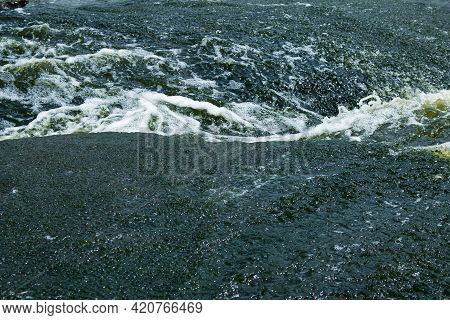 The Texture Of Water On The Surface Of A Small Waterfall In The Ukrainian Steppe Close-up. Tokovsky