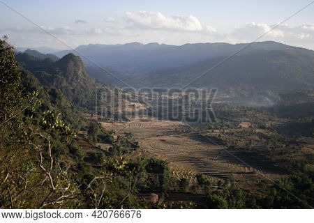 Viewpoint Looking Out Over A Beautiful Valley Landscape With Terraced Rice Fields Farm Lands During