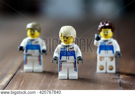 Lego toys car mechanic figure on wooden table close up
