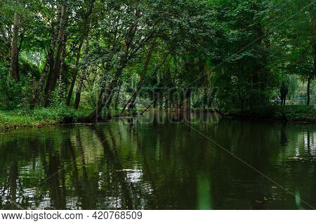 Beautiful Lake In The Center Of The Park. Small Lake In Summer Park. Summer Green Forest With A Smal