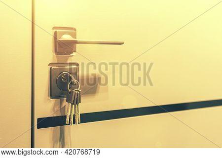 Keys Stuck In A Lock. Closeup Door Lock Keys, Real Estate Concept Door Handle, Key Insert And Hold I