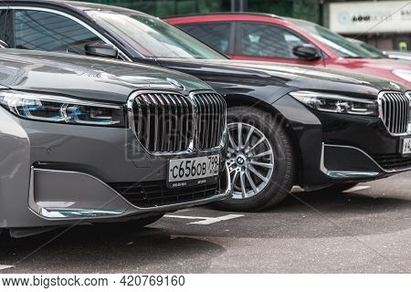 Front Part Of Bmw 750li With Hood And Radiator Grill. Bmw 7 Series G12 Parked Outdoor Near Business