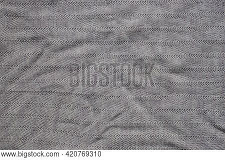 Gray Fabric Texture From A Piece Of Crumpled  Matter On The Cloth