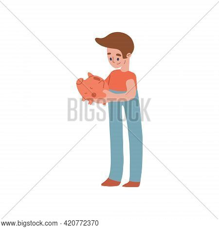 The Boy Holds A Pink Pig Piggy Bank In His Hands And Looks At It. The Image Is About Financial Liter