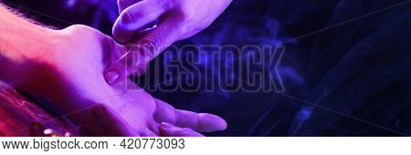 Witch Is A Fortune Teller Reading Good Luck Close-up. Fortune Teller Guides The Lines On The Clients