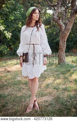 Outdoor Fashion: The Beautiful Young Boho (hippie) Girl In Grove (forest). Portrait Of Sweet Hippy W
