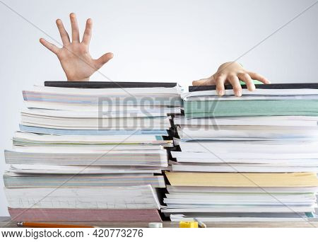Abstract Concept Image Showing A Young Student Behind A Large Pile Of Test Prep Books On A Study Des