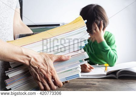 Ambitious Parenting With High Academic Achievement Expectations From Kids Concept. A Mother Is Bring