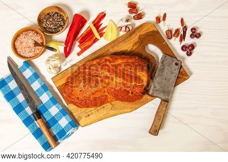 Meat, Pork Neck In Marinade And On A Chopping Boardon. Raw Steak Meat Pork Neck On Chopping Board Wi