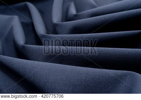Cloth. Background Of A Crumpled Piece Of Gray Fabric In Close-up. Material For Sewing Clothes. Work