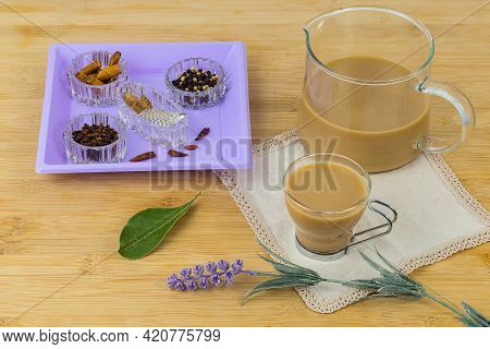 Indian Masala Chai Tea. Masala Chai Spiced Tea With Milk And Spices On Rustic Wooden Table