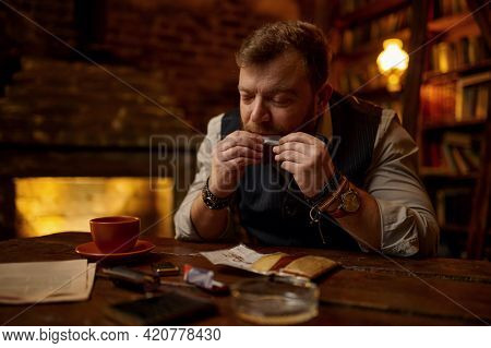 Man drooling a cigarette, tobacco smoking culture