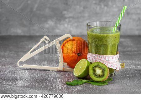 Fresh Smoothie Drink In A Tall Glass Glass With A Centimeter Wrapped Around It And A Caliper Next To