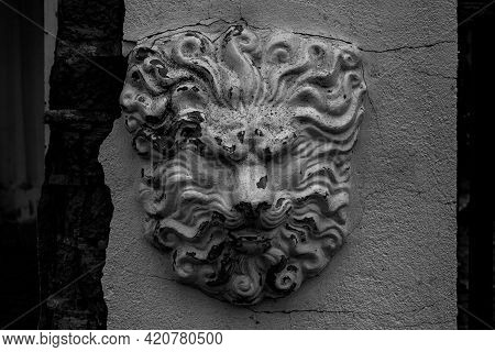 Old Black And White Bas-relief Sculptural Image Of A Lion