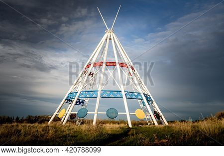 Medicine Hat Alberta Canada, May13 2021: The World's Tallest Tepee Standing Under A Dramatic Sky Nex