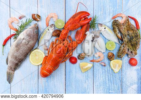 Fresh Raw Seafood On Ice With Herbs And Spices At The Fish Market Food, Fresh Fish And Seafood Plate