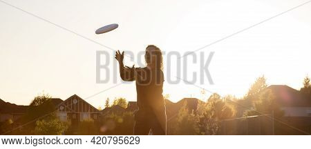 White Caucasian Adult Woman Playing Ultimate Frisbee In The Green Field At Neighborhood City Park. S