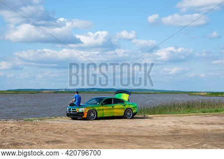 Cypremort Point State Park, La - May 13: Man Fishes From The Hood Of His Customized Car With Changin