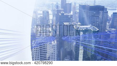 Composition of blue light trails of data and information over cityscape and white edge. global business, connections and technology concept digitally generated image.