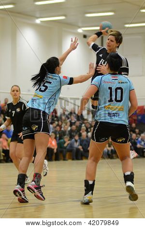 SIOFOK, HUNGARY - FEBRUARY 9: Annamaria Bogdanovic (black) in action at a Hungarian National Championship handball match Siofok KC (black) vs. Fehervar KC (blue),  February 9, 2013 in Siofok, Hungary.