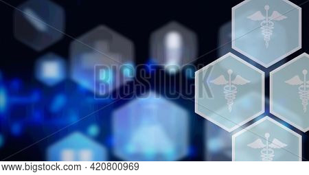 Composition of network of medical icons on hexagons over glowing blue background. global science, medicine and research concept digitally generated image.