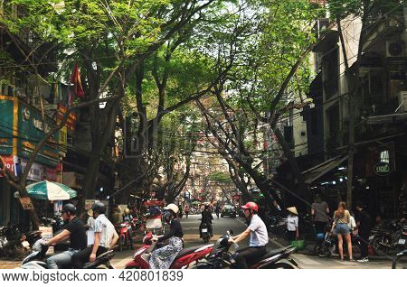 Vietnamese People Riding Biking Driving And Foreign Travelers Travel Visit Old Town And Shopping Loc