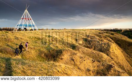 Medicine Hat Alberta Canada, May 13 2021: A Family Hiking Along Seven Persons Coulee With The World'