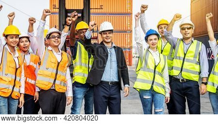 Cargo Container Workers Or Group Of Employee Express Raised Their Hands To Express Their Joy To Cele