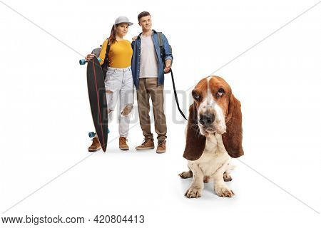 Skater girl and a guy with a basset hound dog on a lead isolated on white background