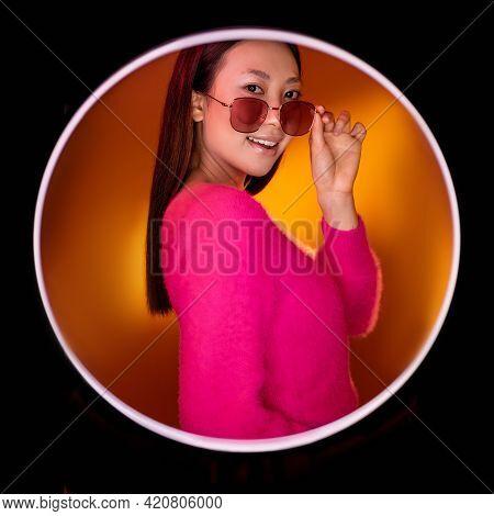 Eyewear Fashion. Beauty Portrait. Modern Accessories. Smiling Glamour Asian Girl In Pink In Sunglass