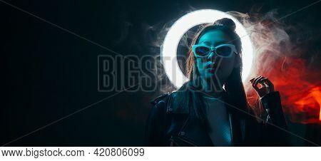 Cyberpunk People. Futuristic Banner. Urban Fashion. Blue Neon Light Asian Girl In Glasses With Glowi