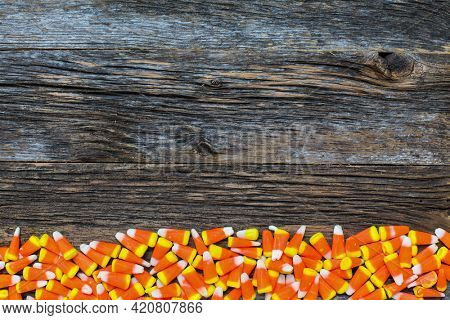 Corn candy on wooden rustic looking wooden background table