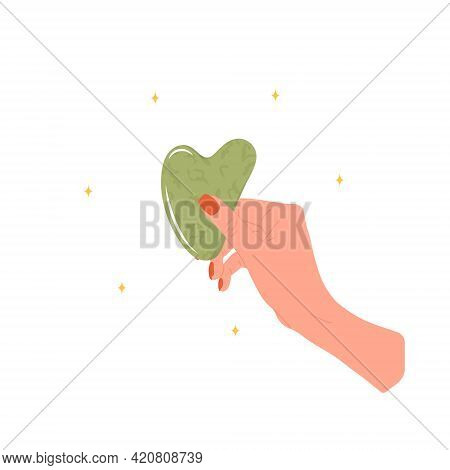 Gua Sha Scraper For Facial Massage. Female Hand Holding Natural Green Nephrite Stone. Trendy Beauty
