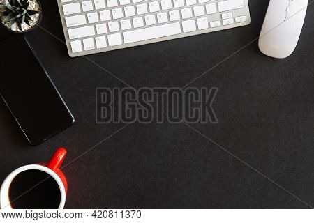 Top View Of An Desk Office Table. Black Office Desk Top With Cup Of Coffee. Working On Desk And Offi