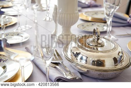 Silverware And Glasses On The Table For Meals